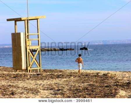 Boy On A Beach