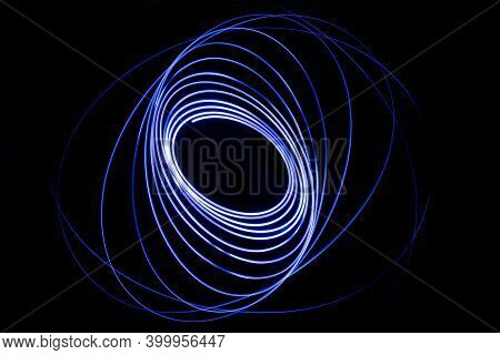 Light Streaks In The Shape Of Circles. A Trace Of A Moving Light Point. Dark Background.