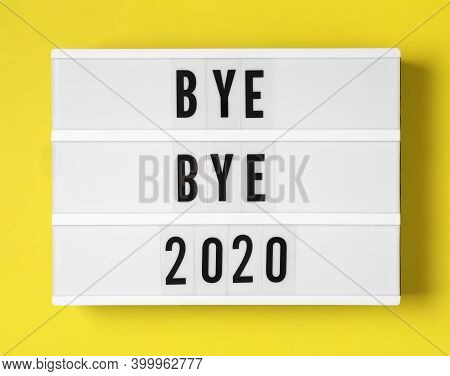 Lightbox With Phrase Bye Bye 2020 On Yellow Background, Top View