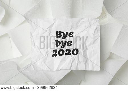 Crumpled Sheet With Text Bye Bye 2020 On Pile Of Toilet Paper, Top View