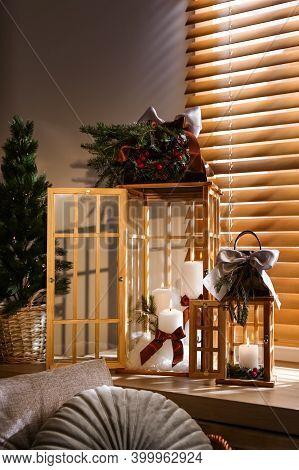 Beautiful Christmas Lanterns On Windowsill In Decorated Room