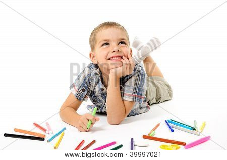 Little Boy Looking For A Drawing