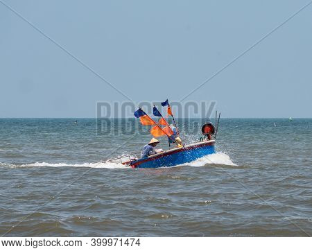 Round Fishing Boat, Typical For The Region, Off The Coast Of Bai Sau Beach In Vung Tau In The Bang R