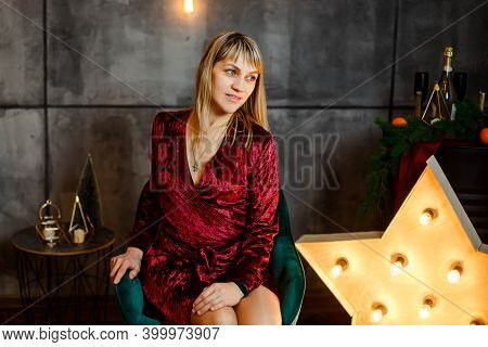 Portrait Of Excited Beautiful Woman. Pretty Female Posing. Young Woman In Christmas Interior. Cozy C
