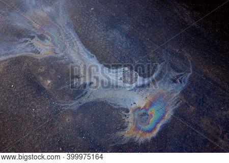 Oil Slick On The Asphalt Road Background