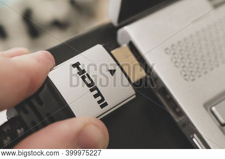 Hdmi 2.0. Hdmi 3.0. 2.0a. Man Holding An Hdmi Plug In His Hand. High-speed Transfer Of Multimedia Da