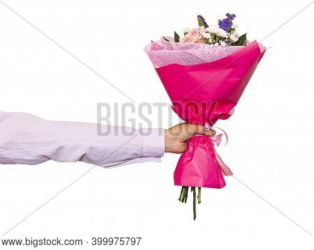 Hand Holding Bunch Of Roses Isolated Against White Background. Beautiful Pink Bouquet Close-up In A