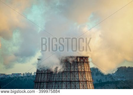 Powerful Industrial Factory Chimney Is Smoking And Polluting The Environment With Carbon Dioxide