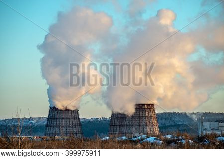Column Of Smoke Is Smoking From The Powerful Pipe Of An Industrial Enterprise. Concept Of Atmospheri