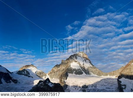 Amazing Breathtaking Scenery In Sunny Day With Blue Sky And Clouds, Beautiful Mountains Area With Sn