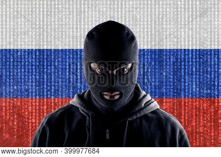 Russian masked computer hacker with black balaclava