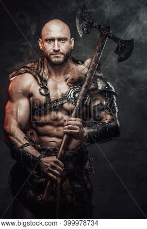 Barbarian With Bald Head And Grimy And Bloody Skin Dressed In Armour With Fur Posing In Dark Smokey