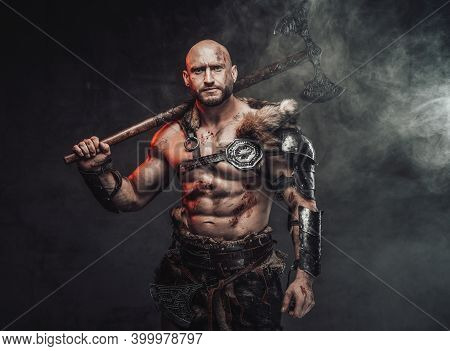 Portrait Of A Viking Warrior With Grimy And Bloody Skin In Light Armour With Fur In Dark Smokey Back