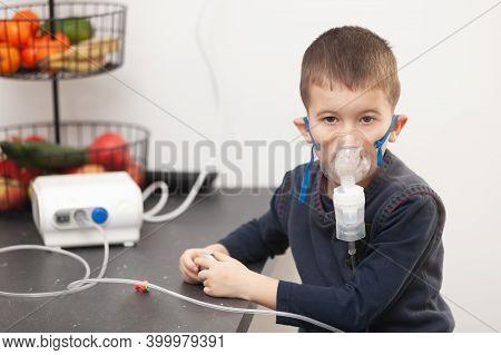 Little Boy Doing His Inhalation With Nebulizer At Home. Child Asthma Inhalation Nebulizer Steam Sick