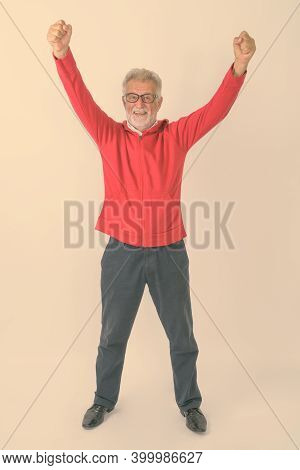 Full Body Shot Of Happy Senior Bearded Man Smiling While Standing And Looking Excited Against White