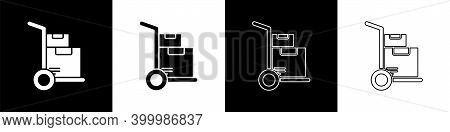 Set Hand Truck And Boxes Icon Isolated On Black And White Background. Dolly Symbol. Vector Illustrat