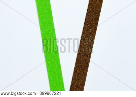 Manicure Tools. Nail Files Isolated On A White Background. The View From The Top. Green Nail File. P