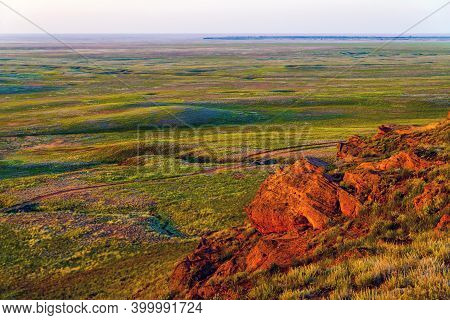 Big Bogdo Mountain. Red Sandstone Outcrops On The Slopes Sacred Mountain In Caspian Steppe Bogdo - B