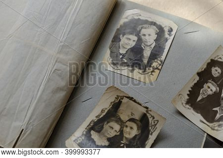 Antique Photos In The Family Photo Album. Old Photos Of Relatives. Touching Moments Of Memories In T