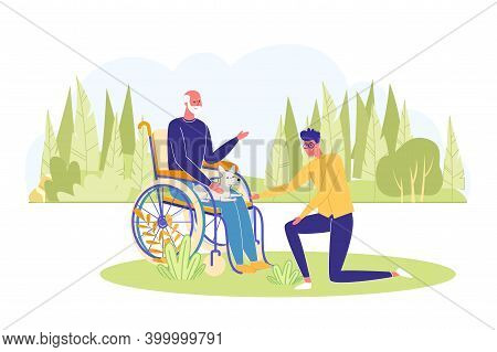 Man With Handicapped Grandfather On Wheelchair Walking In Park. Old And Young People Spending Time T
