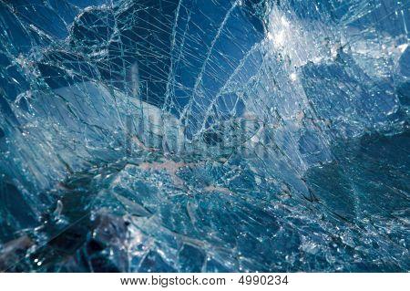 Close-up at broken car windshield. Tint blue poster