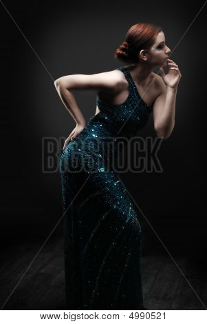 Glamourous Woman Dancing/posing In Blue Dress