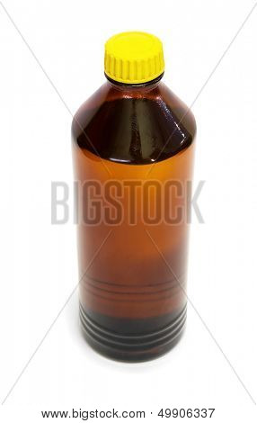 Brown glass bottle of organic solvent isolated on white