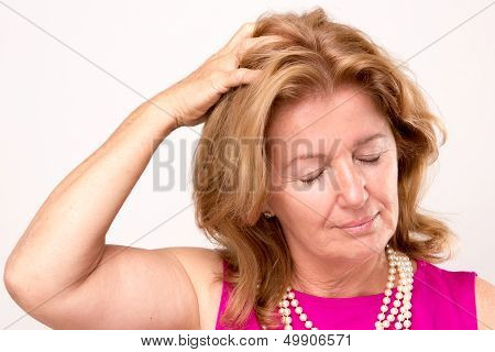 Attractive Middle Aged Woman With A Headache