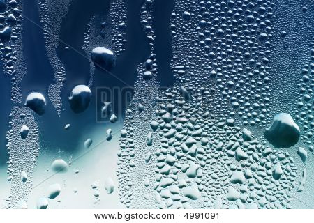 Large and fine water drops on glass poster