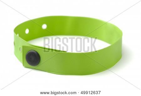 Green plastic ID wristband for hotel or hospital isolated on white