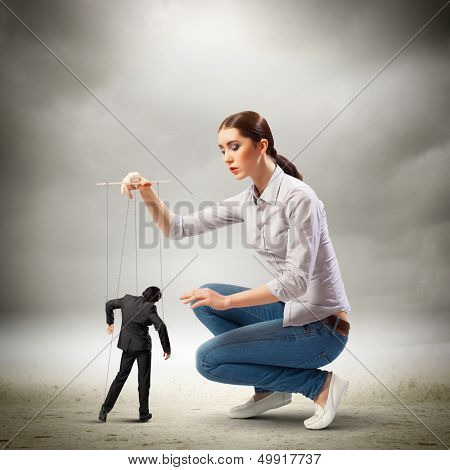 Image of pretty businesswoman puppeteer. Leadership concept