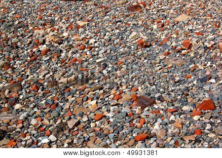 Abstract Grey Stones And Red Clay Brick Pieces