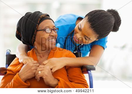 happy senior patient with friendly female nurse