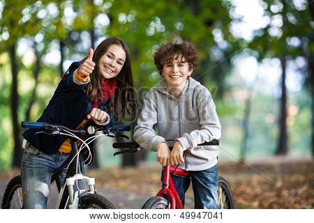 Urban biking - teens and bikes in city park