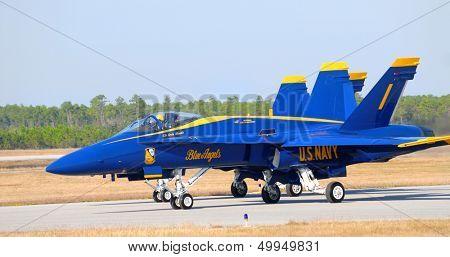 An FA-18 Hornet Navy Blue Angel awaiting takeoff on a runway