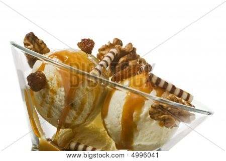 Ice Cream With Walnuts, Raisins, Topping In Dessert Bowl