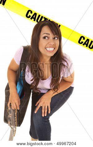 Woman Shopper Under Caution Tape