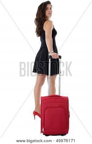 Young Woman Pulling a Red Suitcase