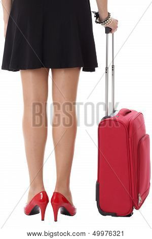 Woman Standing Next to a Red Suitcase