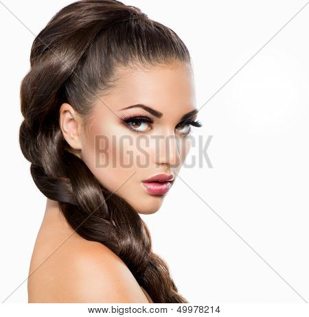 Hair Braid. Beautiful Woman with Healthy Long Hair. Hairdressing. Hairstyle