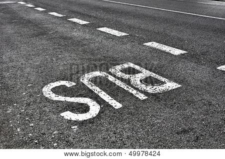 Bus Sign On Tarmac Road