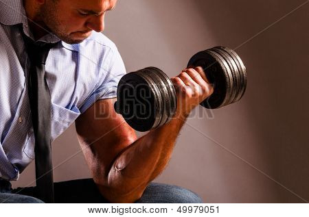 strong business man is raising a dumbbell