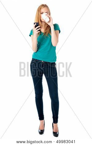 Woman Drinking Coffee And Reading A Sms
