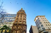 Old historic apartment building in San Telmo neighborhood of Buenos Aires Argentina with birds flying above poster