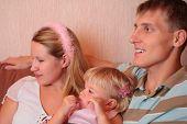 Family with little girl in room focus on little girl poster