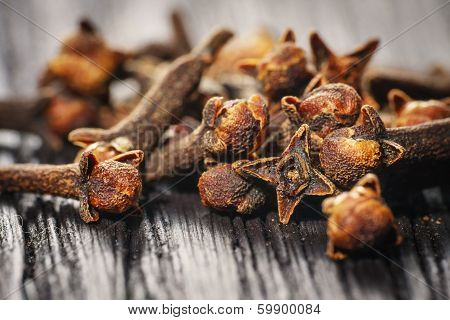 Pile Cloves On Wood Background