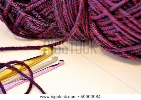 Crochet Hooks And Purple Yarn