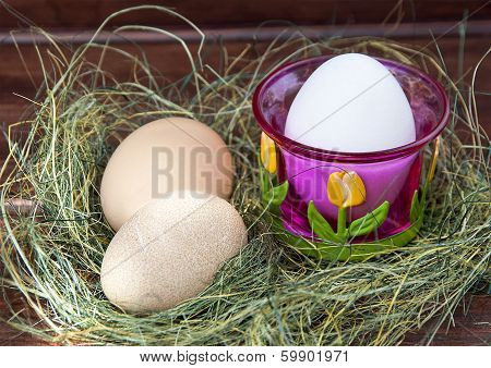 Easter eggs in nest on rustic woode