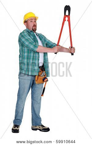 Builder with a pair of boltcutters