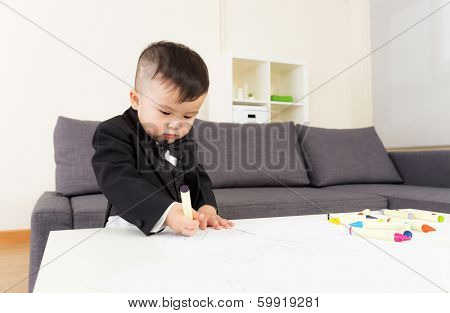 Aisa baby boy concentrate on drawing